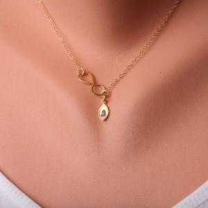Gold Infinity necklace with leaf in..
