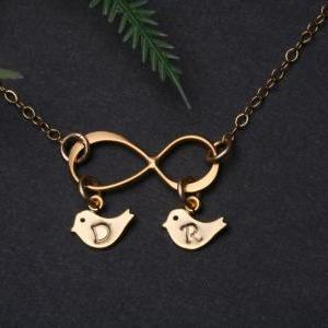 Gold Infinity necklace with bird in..
