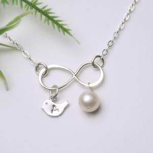 Silver Infinity necklace with bird ..